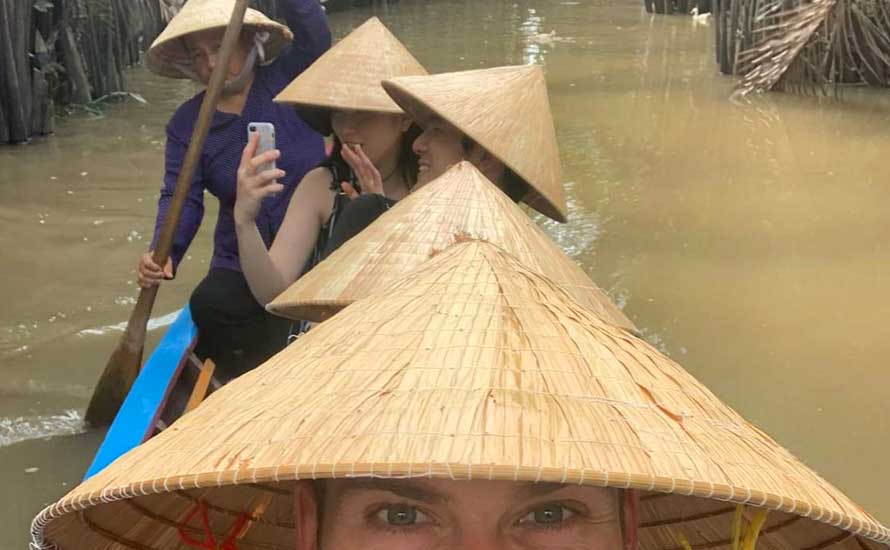 Best-Ho-Chi-Minh-Mekong-Delta-Tour.-The-guide-paddles-on-the-river