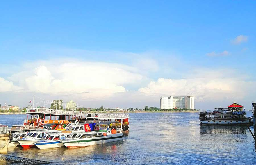How many days do you need in Phnom Penh? A view of the Mekong river with cruises waiting to depart.